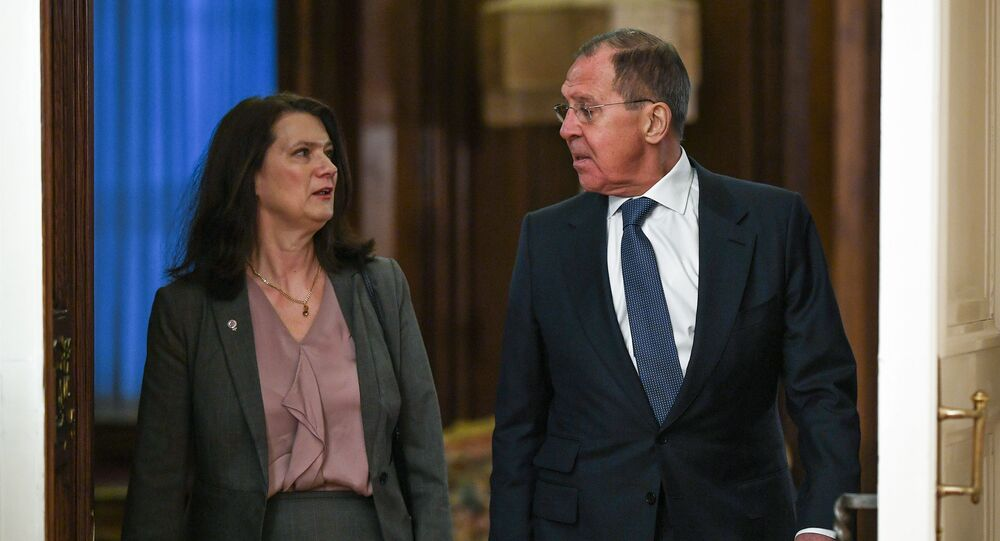 Russian Foreign Minister Sergey Lavrov welcomes his Swedish counterpart Ann Linde during their meeting, in Moscow, Russia
