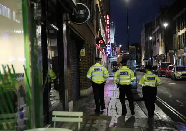 Police officers work in the Soho area of central London on February 3, 2020 after parts of the neighbourhood were evacuated