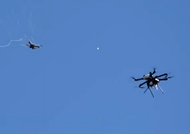 Fortem Technologies' SkyDome-enabled DroneHunter system is seen chasing an enemy drone and capturing the aircraft with its net.