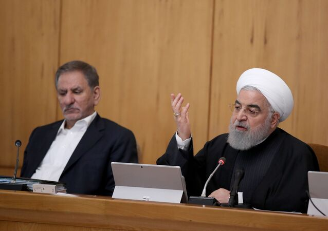 President Hassan Rouhani chairing a cabinet meeting, alongside Iranian Vice President Eshaq Jahangiri
