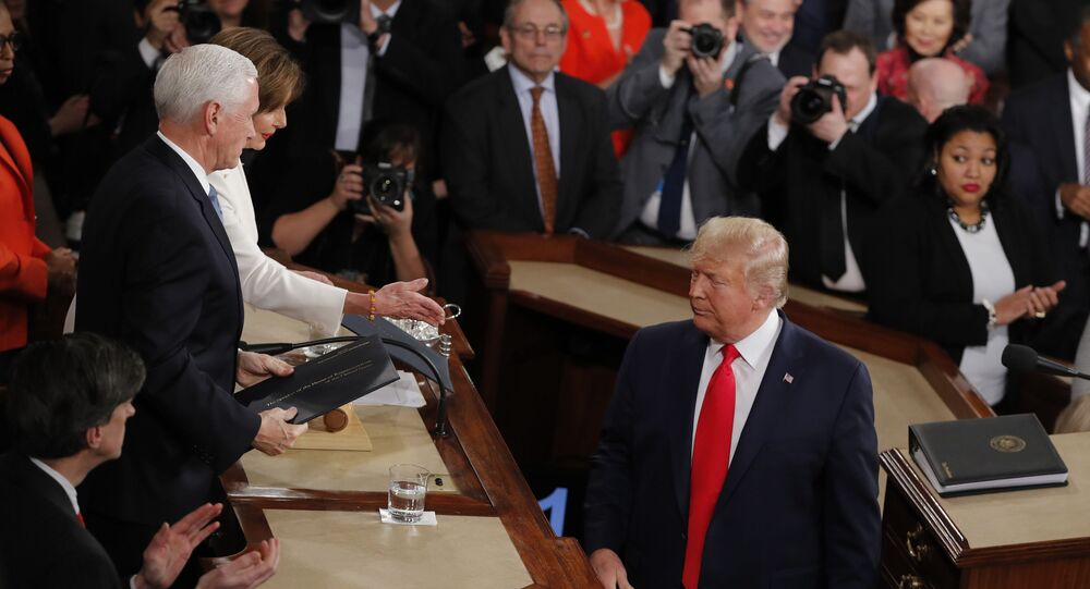 President Donald Trump turns after handing copies of his speech to House Speaker Nancy Pelosi of Calif., and Vice President Mike Pence as he delivers his State of the Union address to a joint session of Congress on Capitol Hill in Washington, Tuesday, Feb. 4, 2020.