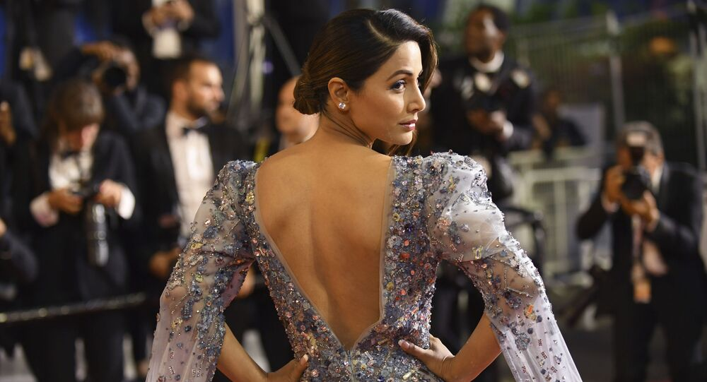 Actress Hina Khan poses for photographers upon arrival at the premiere of the film 'Bacurau' at the 72nd international film festival, Cannes, southern France, Wednesday, May 15, 2019