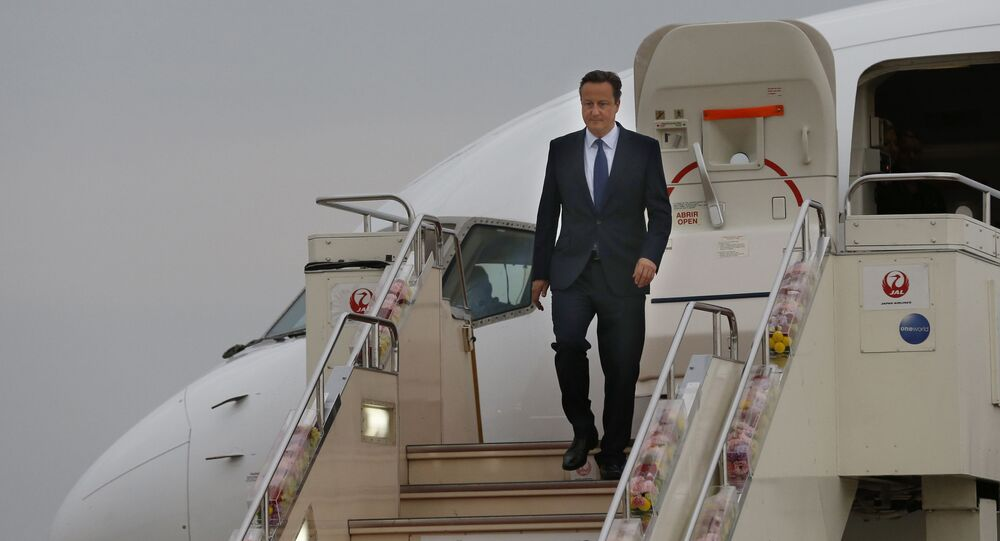 Britain's Prime Minister David Cameron walks down the steps of a plane upon his arrival at Chubu Centrair International Airport in Tokoname, Aichi Prefecture, Japan, for the Group of Seven summit, Wednesday, May 25, 2016