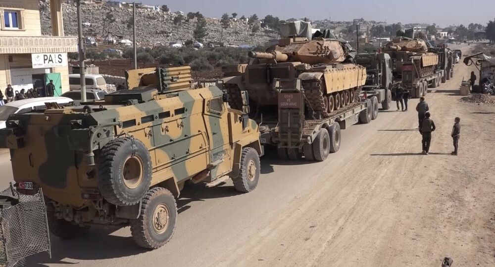 In this frame grab from video taken on Sunday, Feb. 2, 2020, a Turkey Armed Forces convoy is seen at the northern town of Sarmada, in Idlib province, Syria