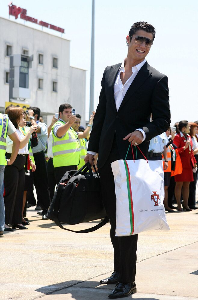 Football player Cristiano Ronaldo poses at Lisbon airport