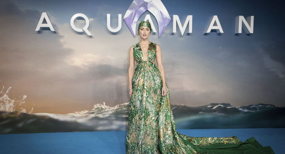 Actress Amber Heard poses for photographers upon arrival at the world premiere of the film 'Aquaman', in London, Monday, Nov. 26, 2018