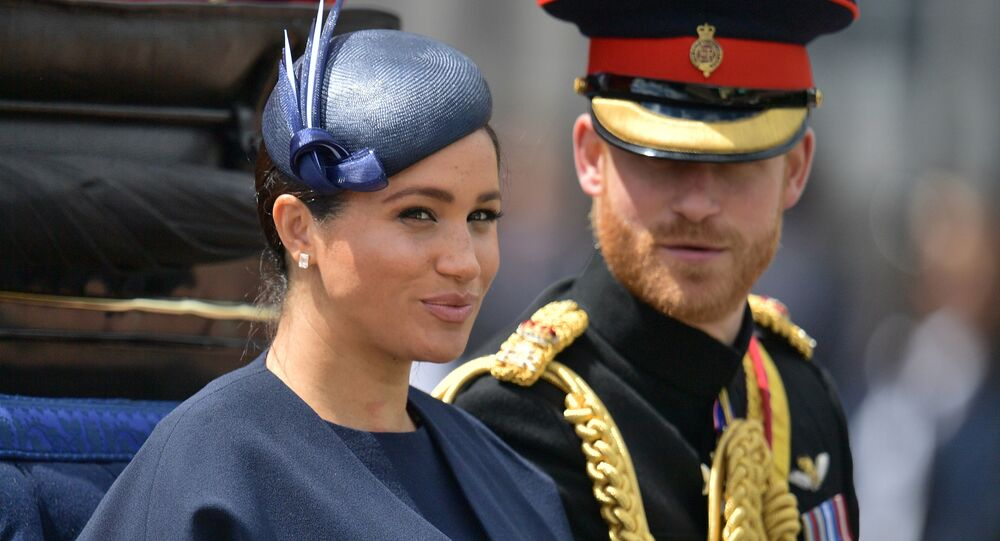 In this file photo taken on June 08, 2019 Britain's Meghan, Duchess of Sussex (L) and Britain's Prince Harry, Duke of Sussex (R) return to Buckingham Palace after the Queen's Birthday Parade, 'Trooping the Colour', in London