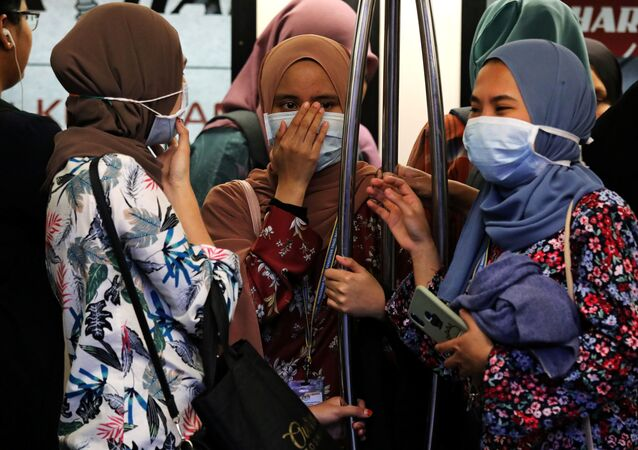 Passengers wear masks to prevent the outbreak of a new coronavirus in a Light Rail Transit train in Kuala Lumpur, Malaysia, January 31, 2020