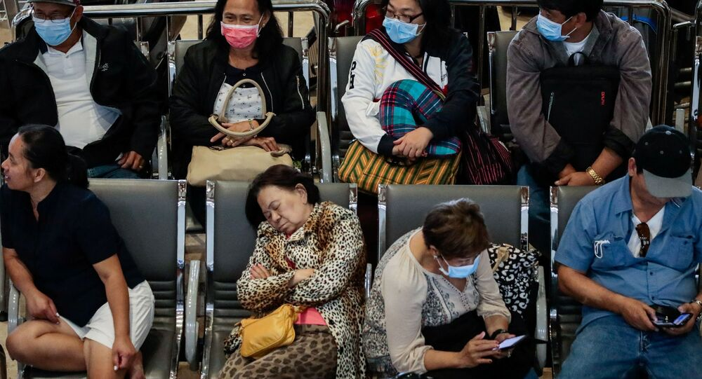 Passengers wait at the departure area while wearing protective masks, following confirmed cases of coronavirus in the country, at Ninoy Aquino International Airport, in Manila, Philippines, 5 February 2020.