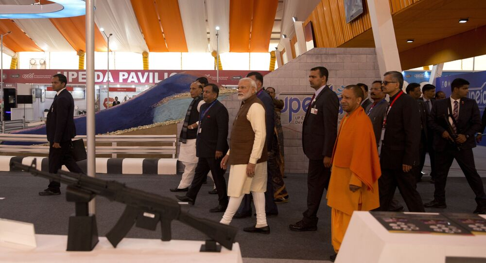 Indian Prime Minister Narendra Modi, center, and Chief Minister of Uttar Pradesh state Yogi Adityanath, in saffron, attend the DefExpo in Lucknow, India, Wednesday, Feb. 5, 2020