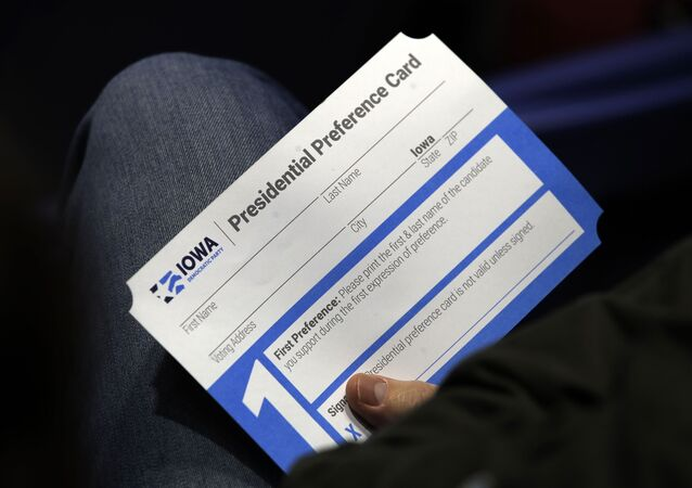 A caucus goer seated in the section for Democratic presidential candidate Sen. Elizabeth Warren, D-Mass., holds their Presidential Preference Card at the Knapp Center on the Drake University campus in Des Moines, Iowa, Monday, Feb. 3, 2020.