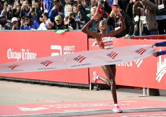 Brigid Kosgei of Kenya, wins the Chicago Marathon setting a world record, while wearing a prototype form of the Nike Vaporfly