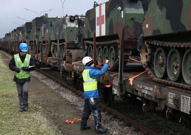 U.S. Army troop carrier vehicles get secured and tagged onto railcars as part of an Army Prepositioned Stock (APS) movement at Coleman Barracks in Mannheim, Germany, Jan. 28, 2019