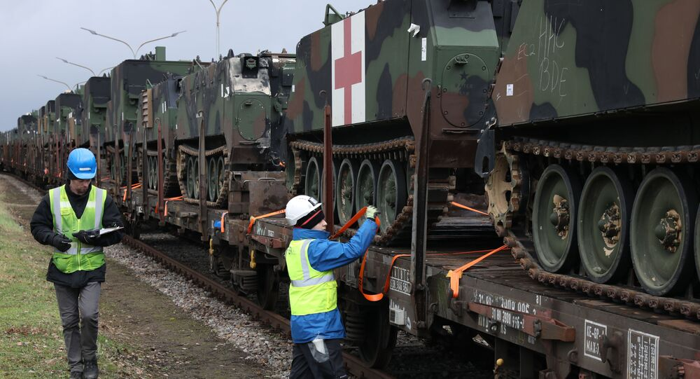 U.S. Army troop carrier vehicles get secured and tagged onto railcars as part of an Army Prepositioned Stock (APS) movement at Coleman Barracks in Mannheim, Germany, 28 January 2019