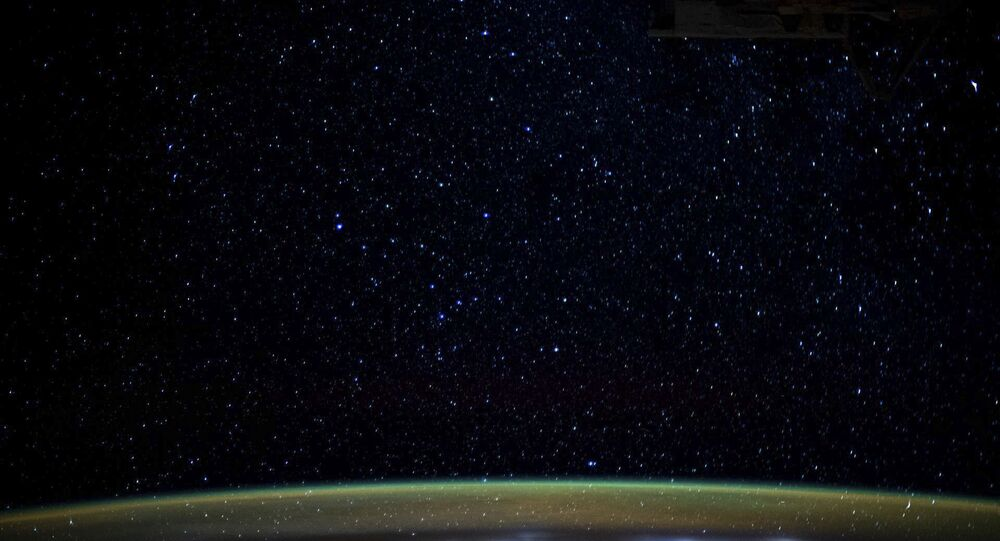 This NASA image obtained on January 5, 2020 shows stars as they glitter in the night sky above the Earth's atmospheric glow