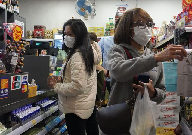 People at a convenience store in Hong Kong