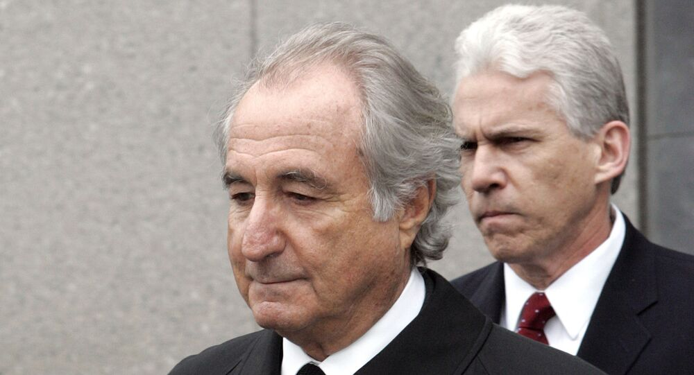 "In this Tuesday, March 10, 2009, file photo, former financier Bernie Madoff exits federal court in Manhattan, in New York. Madoff asked a federal judge Wednesday, Feb. 5, 2020, to grant him a ""compassionate release"" from his 150-year prison sentence, saying he has terminal kidney failure and less than 18 months to live."