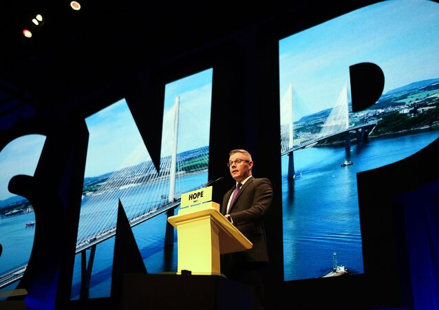 Derek Mackay, Scotland's Minsiter for Finance and the Constitution, and SNP MSP, speaks on the final day of the Scottish National Party (SNP) annual conference in Glasgow on October 9, 2018