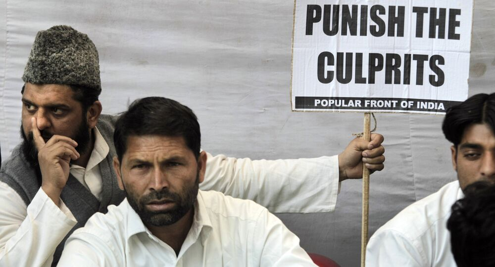 Indian Muslim activists of Popular Front of India sit at a protest in New Delhi, India, Tuesday, Dec. 6, 2011 to mark the anniversary of the Babri mosque demolition