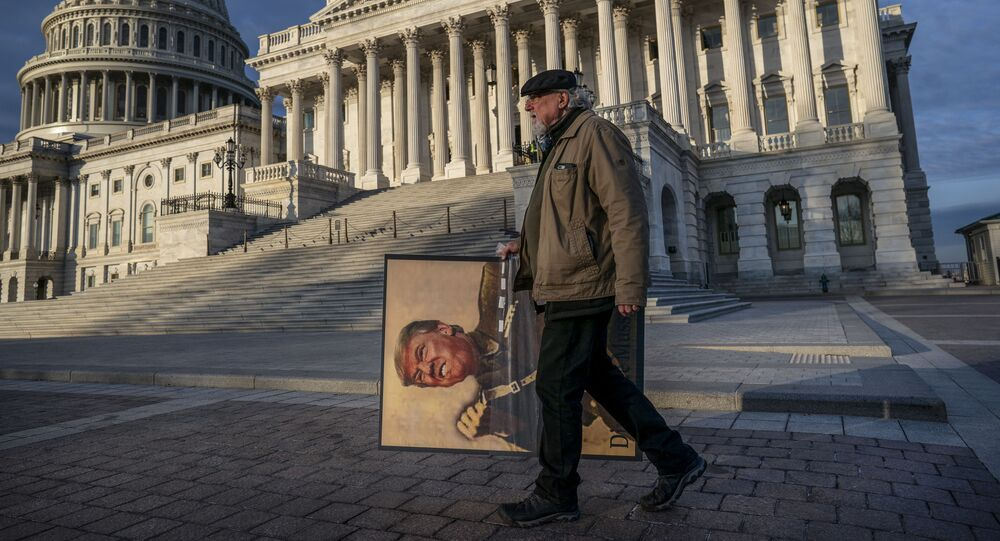 Anti-Trump activist Stephen Parlato of Boulder, Colo., arrives at the Capitol in Washington, early Friday, Jan. 31, 2020, as the Senate resumes the impeachment trial of President Donald Trump on charges of abuse of power and obstruction of Congress.