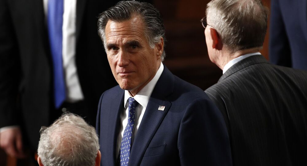 Sen. Mitt Romney, R-Utah, arrives before President Donald Trump delivers his State of the Union address to a joint session of Congress on Capitol Hill in Washington, Tuesday, Feb. 4, 2020.