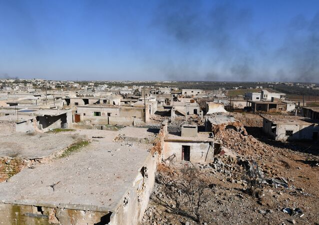 Smoke rises over the Deir Sharqi village, about four kilometres from the town of Maarrat al-Numan, southern Idlib province, Syria. Deir Sharqi and some other jihadist-held villages near the key town Maarrat al-Numan were captured by Syrian army forces.