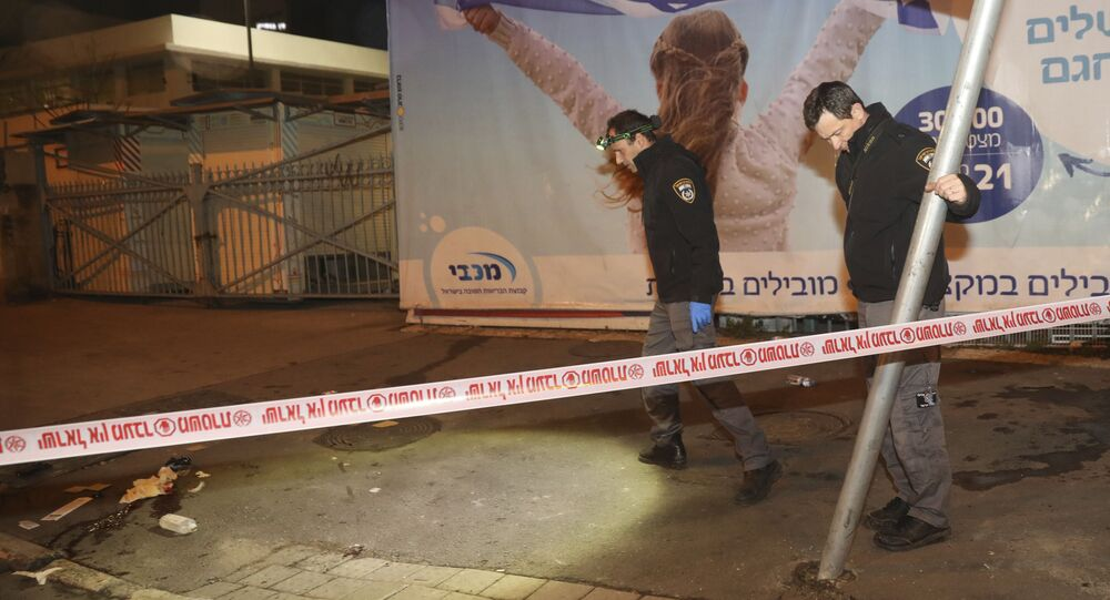 Israeli police officers inspect the scene of an attack in Jerusalem, early Thursday, Feb. 6, 2020