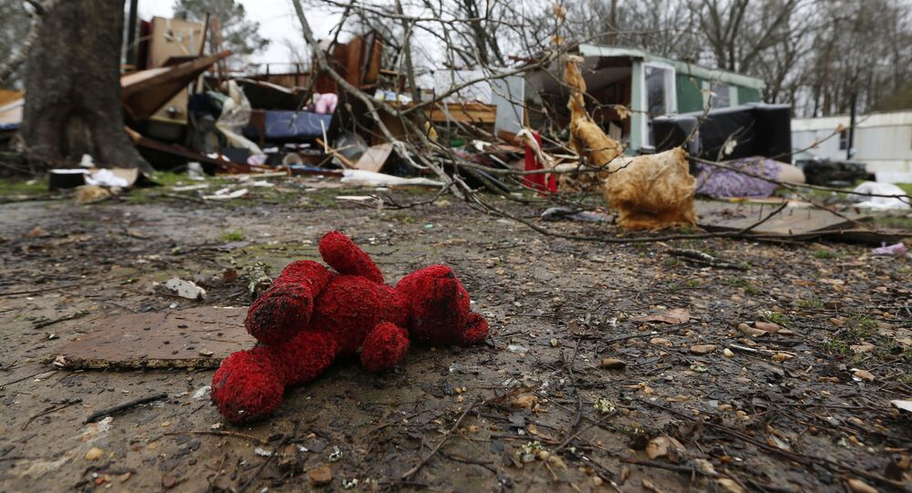 A rain soaked teddy bear lies in the front yard of the remains of Emma Carter's mobile home in Pickens, Miss., Thursday, Feb. 6, 2020. Carter and several family members lay on the living room floor and prayed as severe weather hit the area Wednesday. All survived with minor injuries. (AP Photo/Rogelio V. Solis)
