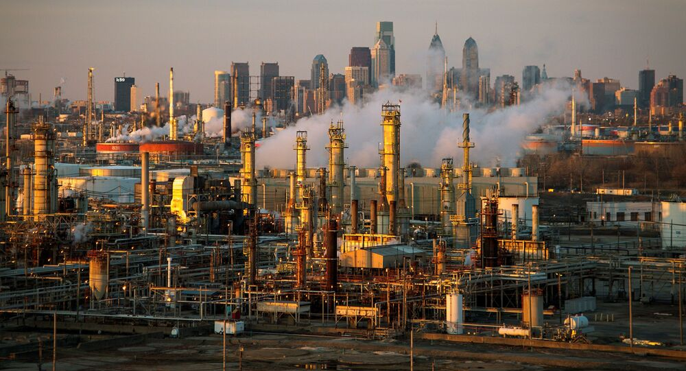 The Philadelphia Energy Solutions oil refinery is seen at sunset in front of the Philadelphia skyline March 24, 2014. Picture taken March 24, 2014