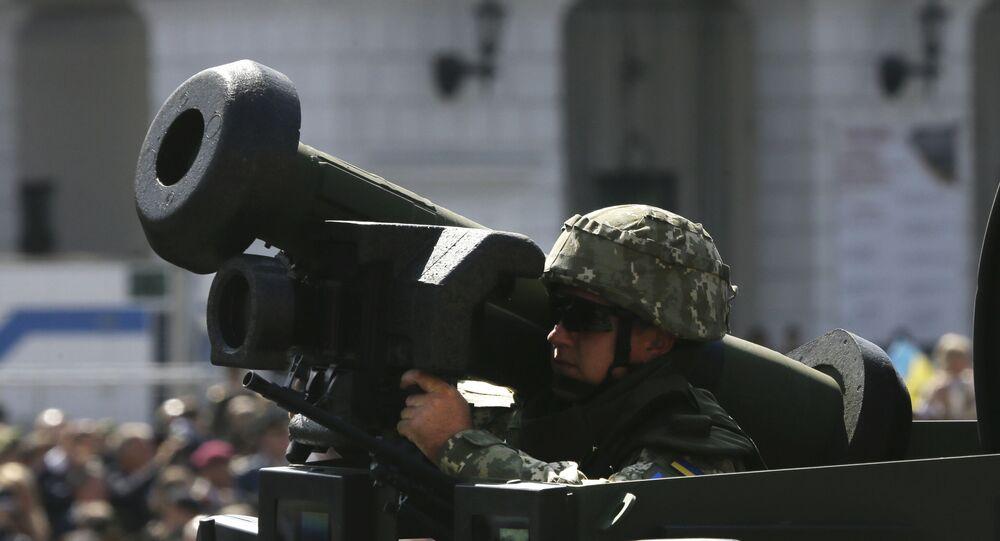 Ukrainian soldier armed with a US Javelin rides down Khreshchatyk Street in downtown Kiev, Ukraine, during Ukraine's Independence Day celebration, 24 August 2018.
