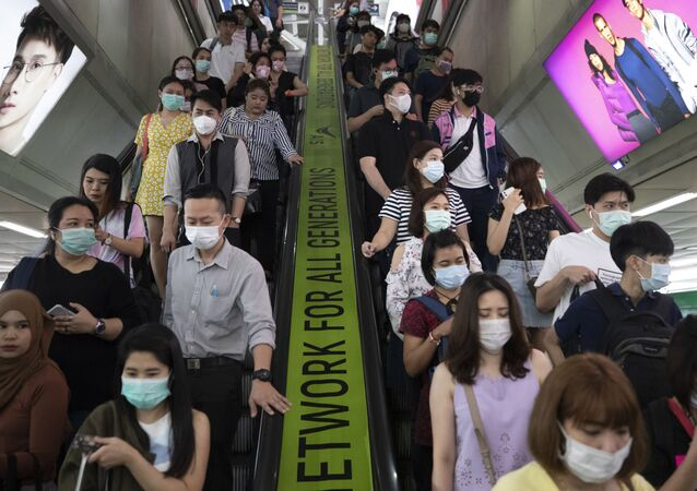 Commuters wear face masks to protect themselves from new virus at the skytrain station in Bangkok, Thailand, Friday, Feb. 7, 2020.