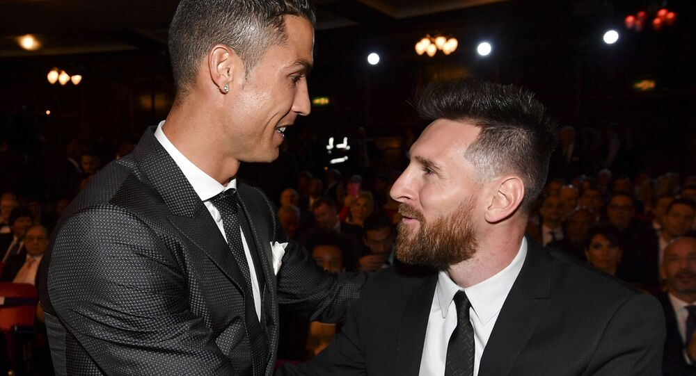 Nominees for the Best FIFA football player, Barcelona and Argentina forward Lionel Messi (R) and Real Madrid and Portugal forward Cristiano Ronaldo (L) chat before taking their seats for The Best FIFA Football Awards ceremony, on October 23, 2017 in London