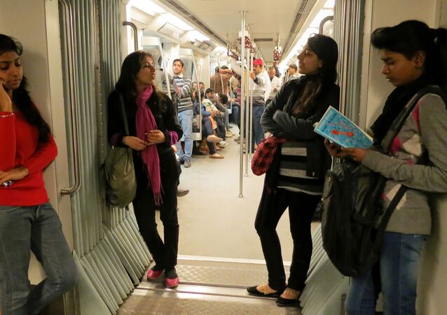Indian women travel inside a Women Only metro train compartment in New Delhi, India, Saturday, Feb. 2, 2013