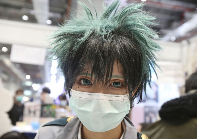 A visitor in a costume wears face masks at the Comic Exhibition in Taipei, Taiwan, Sunday, Feb. 2, 2020
