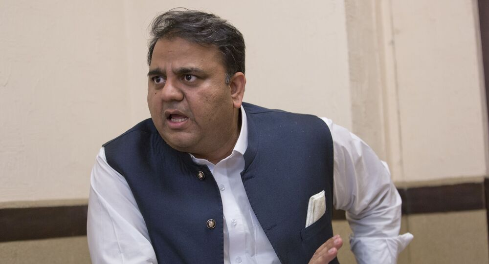 In this Tuesday, Sept. 25, 2018 photo, Pakistani Information Minister Fawad Chaudhry speaks to The Associated Press, in Islamabad, Pakistan.