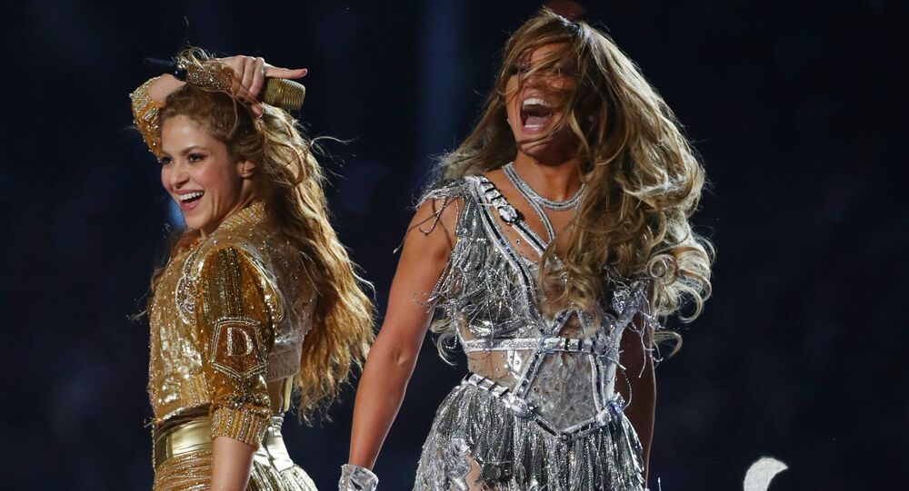 Feb 2, 2020; Miami Gardens, Florida, USA; Recording artists Shakira (left) and Jennifer Lopez (right) perform at halftime in Super Bowl LIV between the Kansas City Chiefs and San Francisco 49ers at Hard Rock Stadium