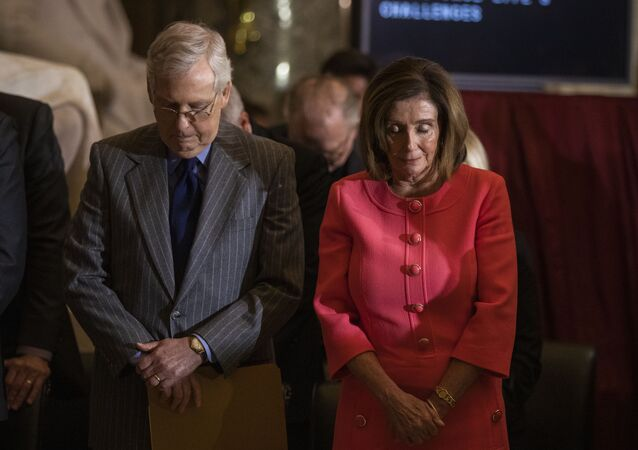 House Speaker Nancy Pelosi and Senate Majority Leader Mitch McConnell of Ky., bow their heads and pray during a Congressional Gold Medal ceremony honoring amyotrophic lateral sclerosis (ALS) advocate and former National Football League (NFL) player, Steve Gleason, in Statuary Hall on Capitol Hill, Wednesday, Jan. 15, 2020, in Washington.