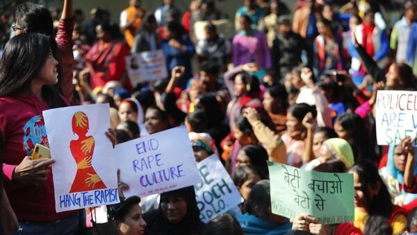 Women activists hold banners and shout slogans demanding justice in the case of a veterinarian who was gang-raped and killed last week, during a protest in New Delhi, India, Tuesday, Dec. 3, 2019 - Sputnik International