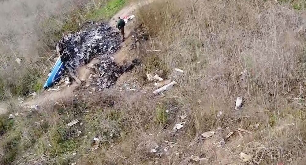 The site of the helicopter crash that killed Kobe Bryant and eight others is seen in a screen grab from drone footage taken in Calabasas, California, U.S. January 27, 2020 and released by the National Transportation Safety Board