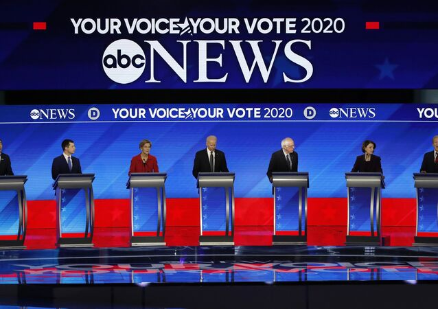 From left, Democratic presidential candidates entrepreneur Andrew Yang, former South Bend Mayor Pete Buttigieg, Sen. Bernie Sanders, I-Vt., former Vice President Joe Biden, Sen. Elizabeth Warren, D-Mass., Sen. Amy Klobuchar, D-Minn., and businessman Tom Steyer participate Friday, Feb. 7, 2020,in a Democratic presidential primary debate hosted by ABC News, Apple News, and WMUR-TV at Saint Anselm College in Manchester, N.H.