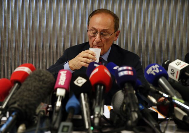 French Ice Skating Federation (FFSG) president Didier Gailhaguet takes a drink as he speaks to the media during a press conference in Paris, Wednesday, Feb. 5, 2020