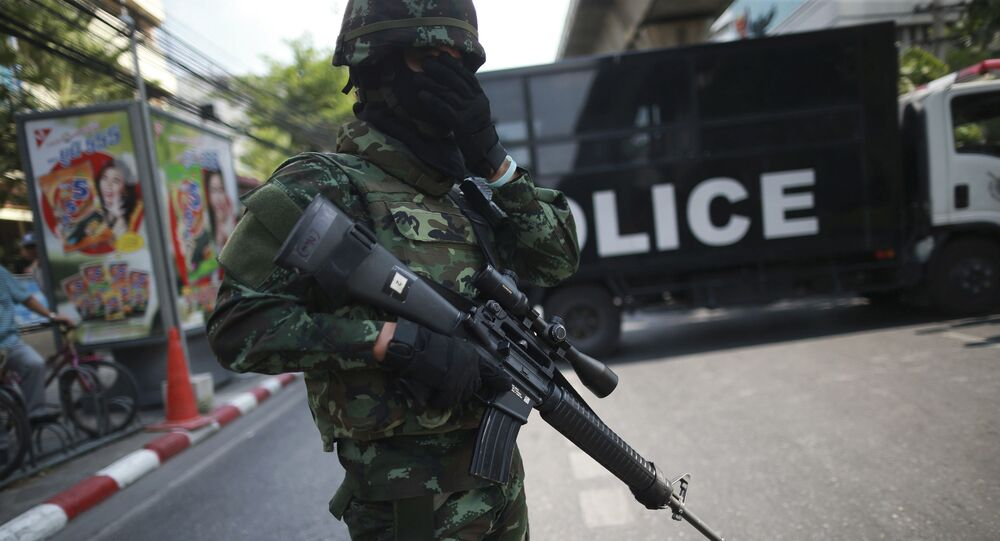 An Armed Thai Soldier Stands in Front of a Police Truck in Bangkok, Thailand