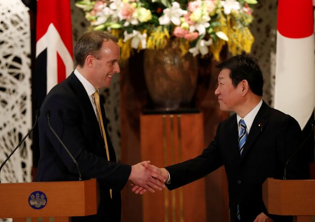 British Foreign Secretary Dominic Raab and Japanese Foreign Minister Toshimitsu Motegi attend their joint news conference after their meeting in Tokyo, Japan February 8, 2020.