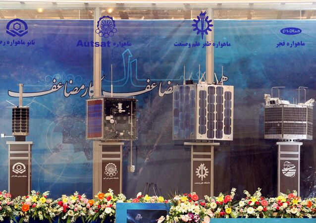 Iran's prototypes of four new satellites (from L) Rasad, Amir Kabir-1, Zafar and Fajr, are on display during their unveiling ceremony in Tehran on 7 February 2011