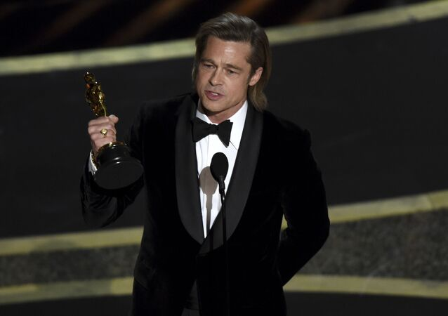 Brad Pitt accepts the award for best performance by an actor in a supporting role for Once Upon a Time in Hollywood at the Oscars on Sunday, Feb. 9, 2020, at the Dolby Theatre in Los Angeles.