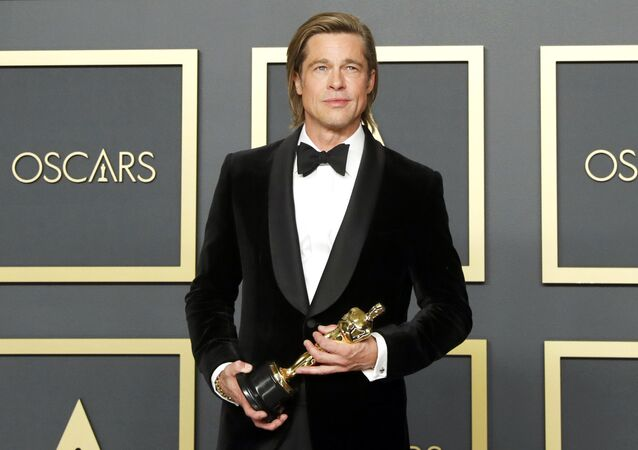 Best Supporting Actor Brad Pitt poses with the Oscar in the photo room during the 92nd Academy Awards in Hollywood, Los Angeles, California, U.S., February 9, 2020.