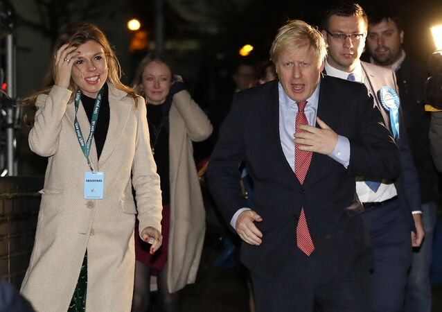 Britain's Prime Minister and Conservative Party leader Boris Johnson and his partner Carrie Symonds arrives for the Uxbridge and South Ruislip