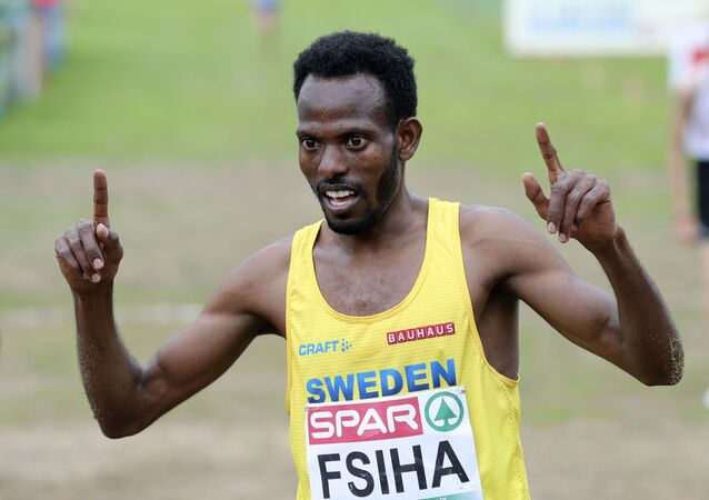 Robel Fsiha of Sweden celebrates after crossing the finish line to win the Men's race during the European Cross Country Championships at the Bela Vista park in Lisbon, Sunday, Dec. 8, 2019Robel Fsiha of Sweden celebrates after crossing the finish line to win the Men's race during the European Cross Country Championships at the Bela Vista park in Lisbon, Sunday, Dec. 8, 2019