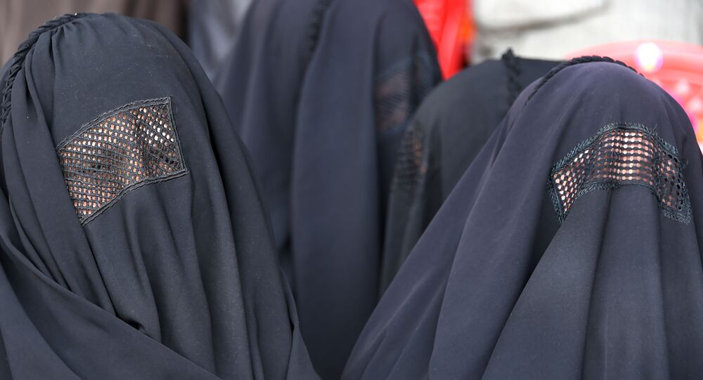 Kashmiri Bhartiya Janata Party (BJP) activists wearing burqa attend a party workers convention ahead of the upcoming general elections in Srinagar on March 14, 2019. - India is not just the world's biggest democracy, its elections are also the most gruelling -- with nearly six weeks between the first round of voting on April 11 and the last