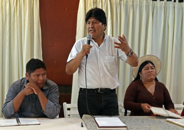 Bolivian ex-president Evo Morales (C), exiled in Argentina, speaks flanked by members of his Movimiento al Socialismo - Movement for Socialism - (MAS) party